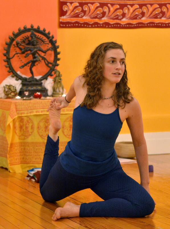 Molly Kitchen leads her yoga class Tuesday
