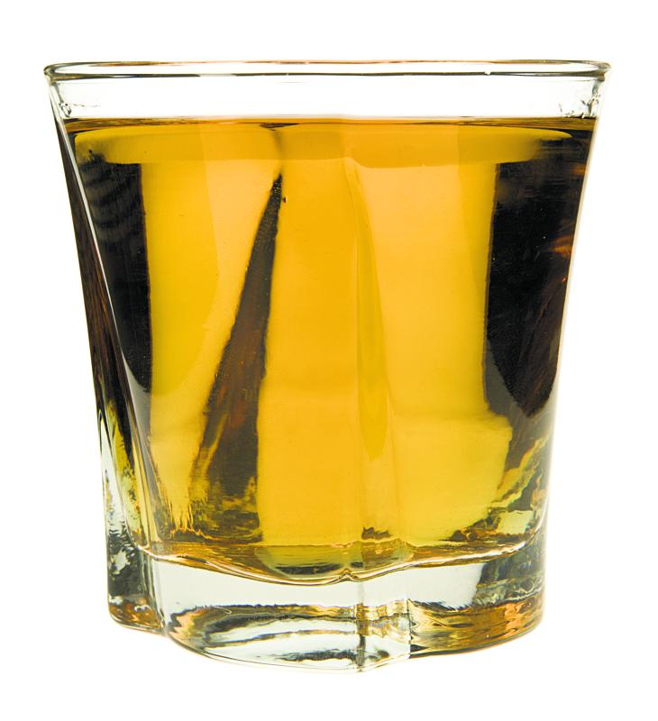 Shot glass with whiskey - Jupiterimages | PhotoObjects.net