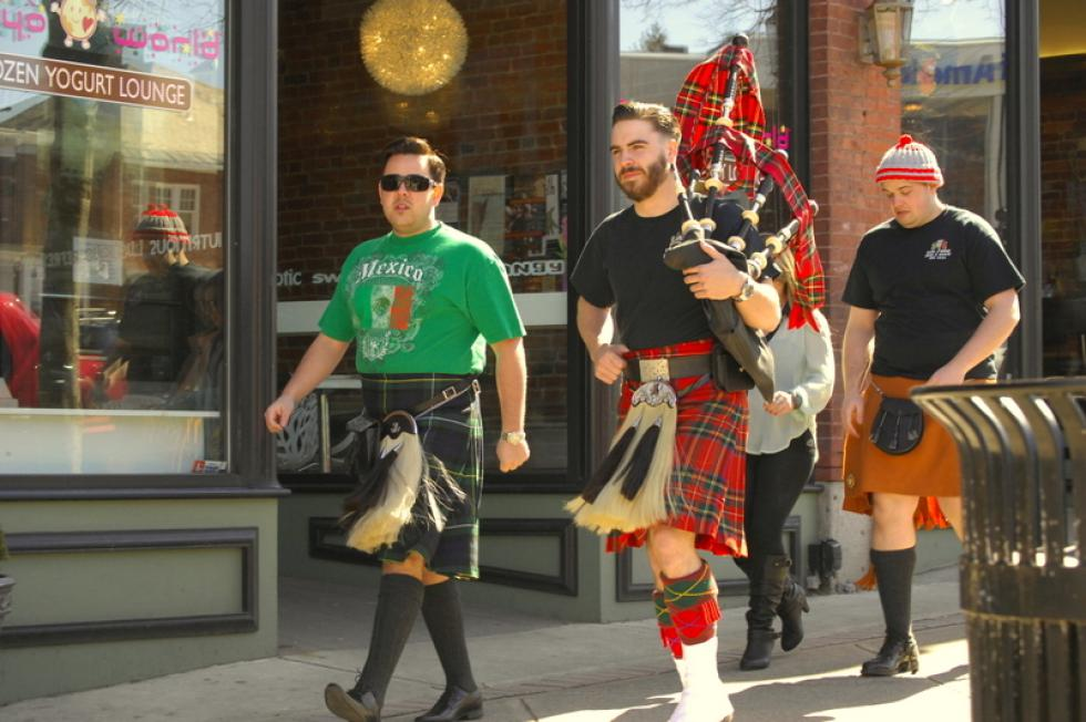 TOM RELIHAN A bagpipe player prepares to enter McMurphy's Uptown Tavern on North Pleasant Street in Amherst during the Barney Blowout on Saturday. - Picasa  