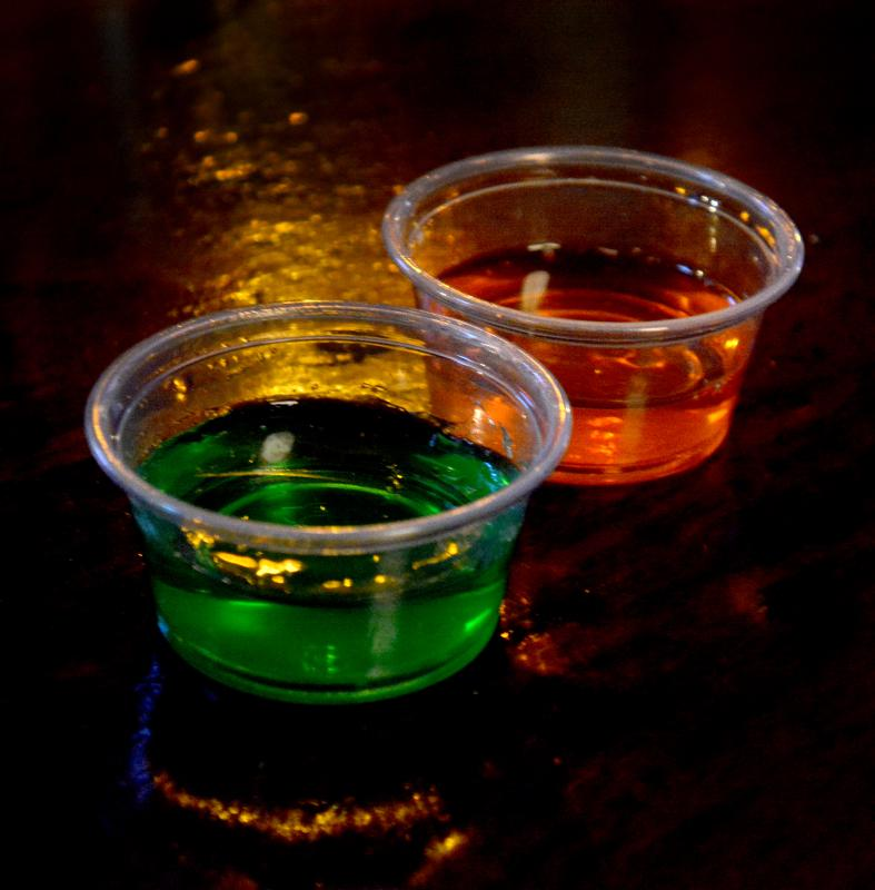 JERREY ROBERTS Jello shots at Ye Ol' Watering Hole in Northampton. Tequila-Lime, front, and Orange Cocao-Vodka. - JERREY ROBERTS | DAILY HAMPSHIRE GAZETTE