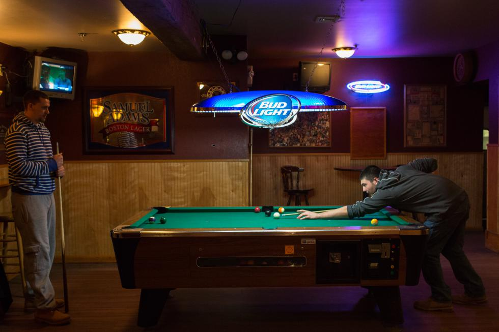 MATT BURKHARTT Jacob Eugin, of Turners Falls, a student at Westfield State, plays pool with Kyle Canole of Milford, also a Westfield State student, at the Maple Leaf bar in Westfield Wednesday February 25 - Matt Burkhartt |