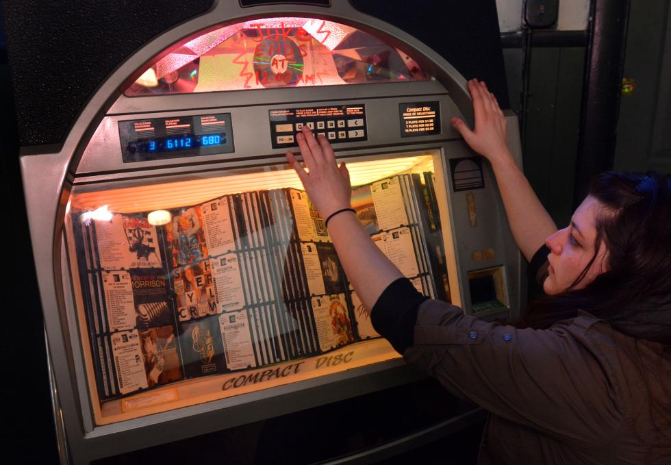 JERREY ROBERTS Kirsten Ross, of Northampton, makes selections on a jukebox at Hugo's in Northampton. - JERREY ROBERTS | DAILY HAMPSHIRE GAZETTE