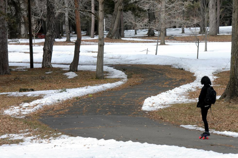KEVIN GUTTING Wednesday afternoon, March 25, 2015, and the snow pack shows signs of receding from the main walkway at Childs Park in Northampton. - KEVIN GUTTING | Daily Hampshire Gazette