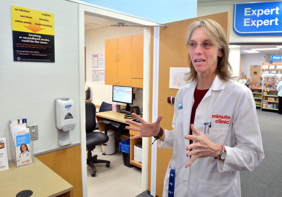 JERREY ROBERTS Connie Turner, who is a nurse practitioner, talks about the CVS Minute Clinic Wednesday at its Northampton location on King Street. - JERREY ROBERTS | DAILY HAMPSHIRE GAZETTE