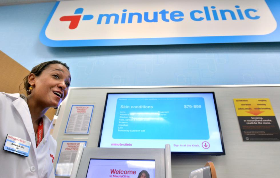 JERREY ROBERTS Brittany Silva, who is a nurse practitioner, talks about the CVS Minute Clinic Wednesday at its Northampton location on King Street. - JERREY ROBERTS | DAILY HAMPSHIRE GAZETTE