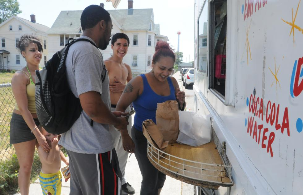 CAROL LOLLIS Crystal Diaz with Nate Pannell,2, Justin  Morales, (no shirt)  Telisha Vazquez (blue) and Christoper Harris, at Raomon De Jesus food truck in Springfield. - Carol Lollis | Daily Hampshire Gazette