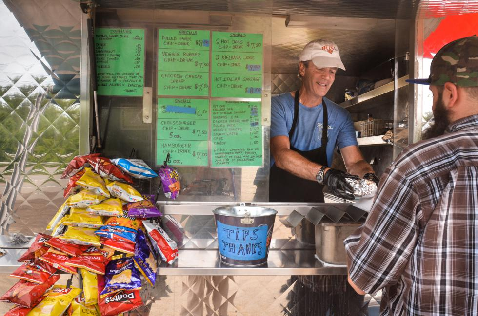 JERREY ROBERTS Mike Foley, owner of Foley's Franks, works in his food trailer Tuesday, May 26, on Mount Tom Road (Rte. 5) in Northampton. - JERREY ROBERTS | DAILY HAMPSHIRE GAZETTE