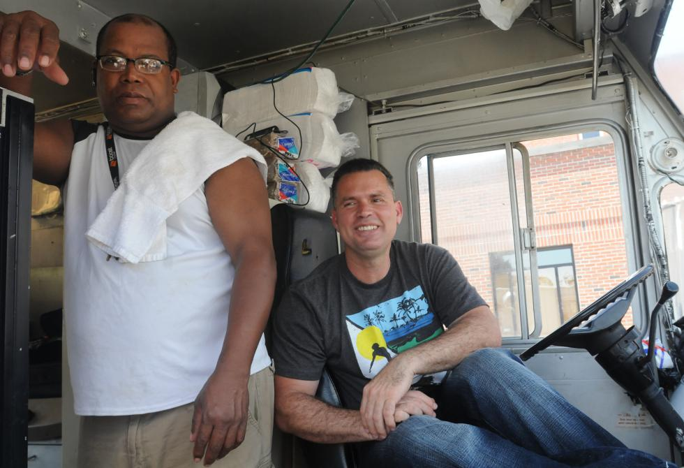 CAROL LOLLIS Ramon De Jesus and Franklin Matos in the food truck in Springfield. - Carol Lollis | Daily Hampshire Gazette