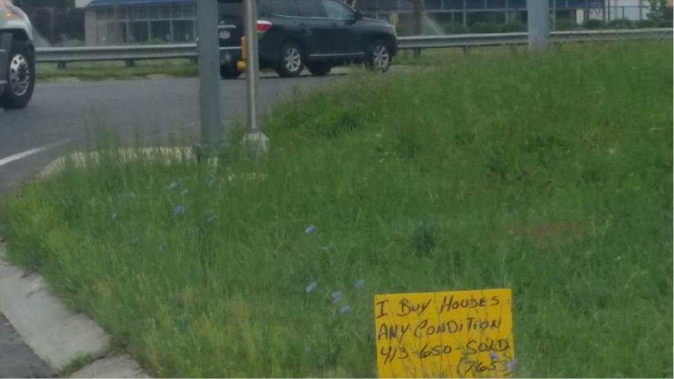 The Uncanny Valley: WTF, Are roadside signs offering to buy homes in 'any condition' a scam?