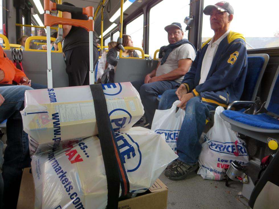 KEVIN GUTTING Osvaldo Morales, right, 68 of Chestnut Street in Springfield rides the westbound PVPA B-7 bus home after shopping at the Price Rite supermarket on Boston Road in Springfield on Friday. - KEVIN GUTTING | DAILY HAMPSHIRE GAZETTE