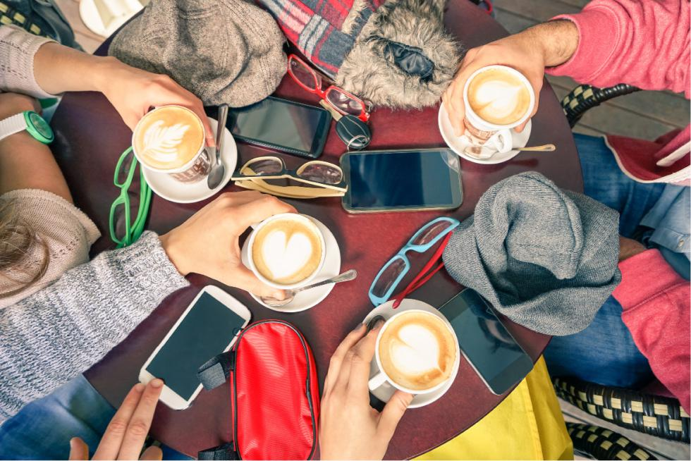 Group of friends drinking cappuccino at coffee bar restaurants - ViewApart | iStockphoto