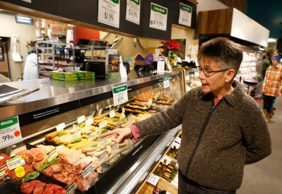 DAN LITTLE President of the board of directors, Dorian Gregory, Wednesday at River Valley Market Co-op in Northampton. - DAN LITTLE | DAN LITTLE