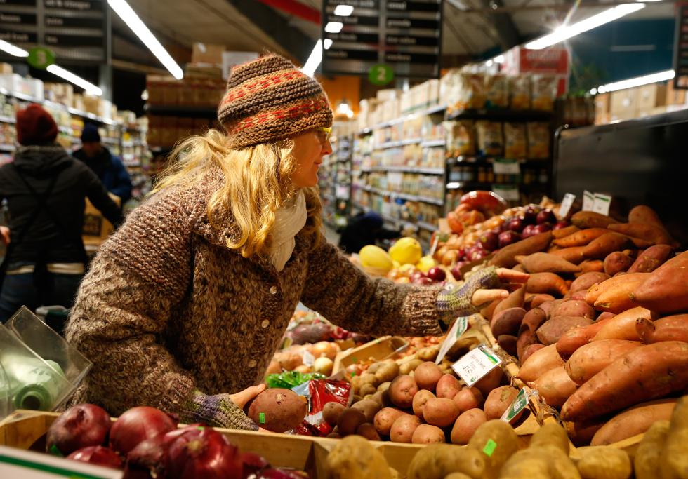 DAN LITTLE Beth Fairservice, of Williamsburg, shops Wednesday at River Valley Market Co-op in Northampton. - DAN LITTLE | DAN LITTLE