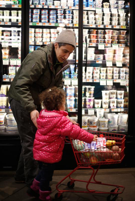 DAN LITTLE Cynthia Conti, of Northampton, shops with her 2-year-old daughter Kiara on Wednesday at River Valley Market Co-op in Northampton. - DAN LITTLE | DAN LITTLE