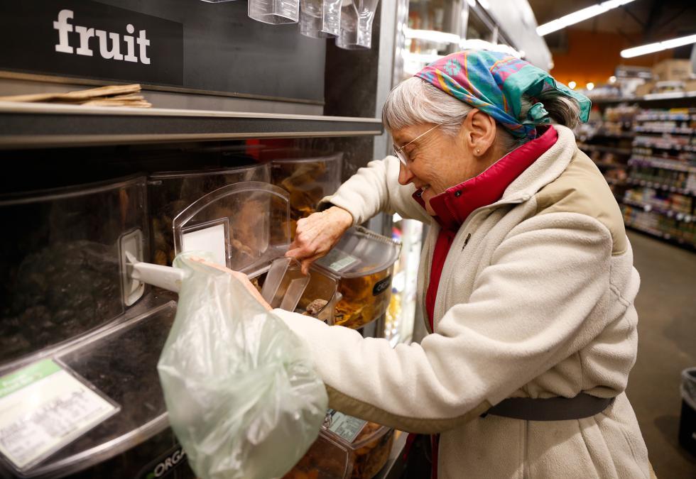 DAN LITTLE Gaella Elwell, of Conway, shops Wednesday at River Valley Market Co-op in Northampton. - DAN LITTLE | DAN LITTLE