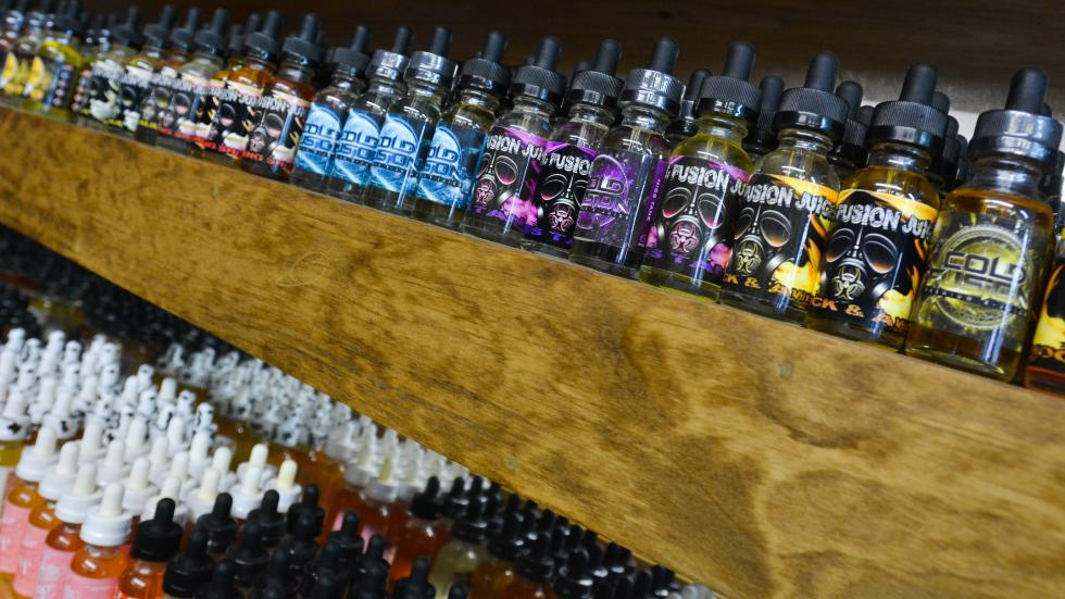 Bottles of vape rest on shelves at Voltage Vape in Springfield, Tuesday, March 8. - JERREY ROBERTS   DAILY HAMPSHIRE GAZETTE