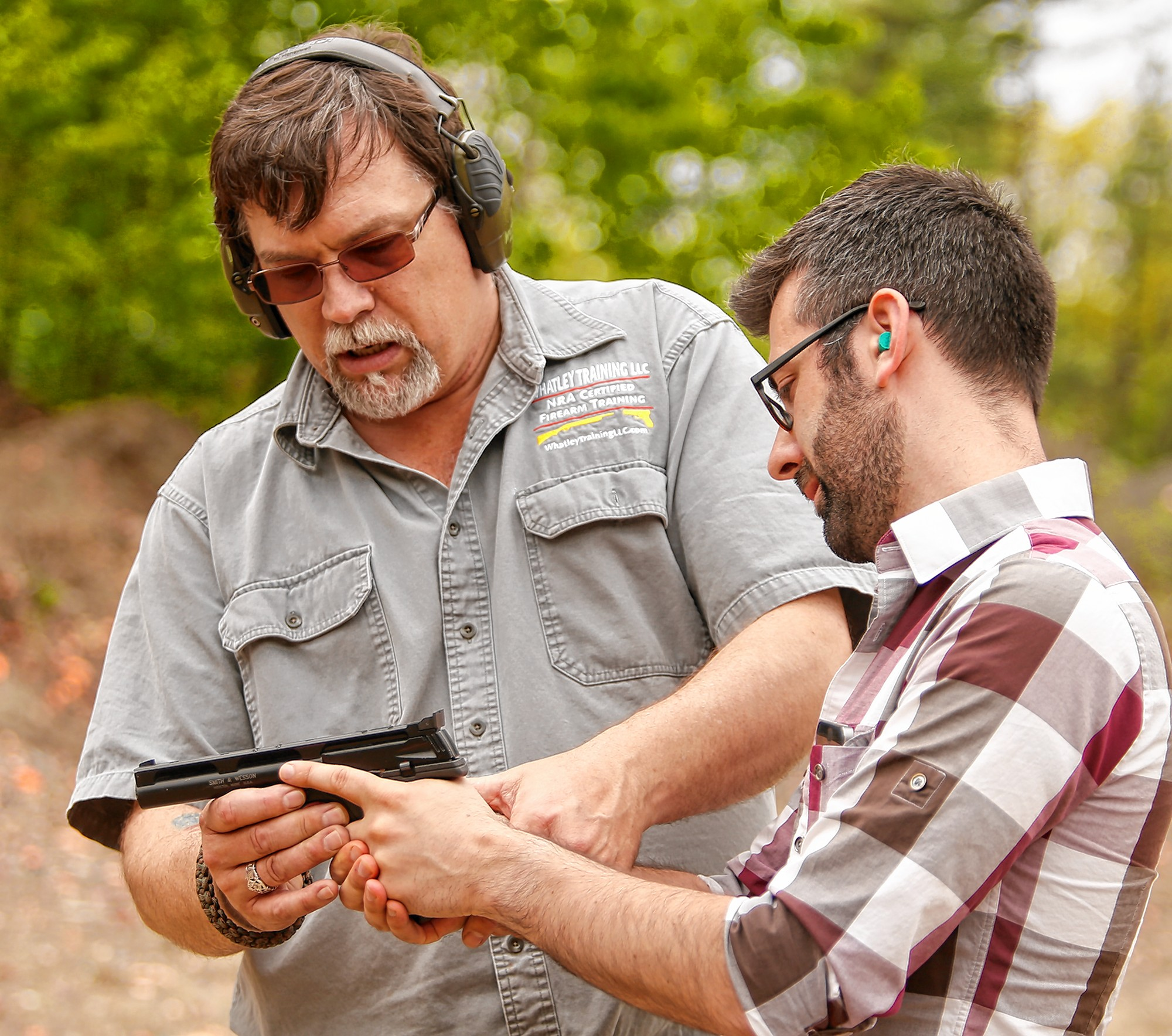 Kirk Whatley, left, instructs Valley Advocate reporter Hunter Styles during a group firearms training class Saturday at Norwottuck Fish and Game in Amherst.