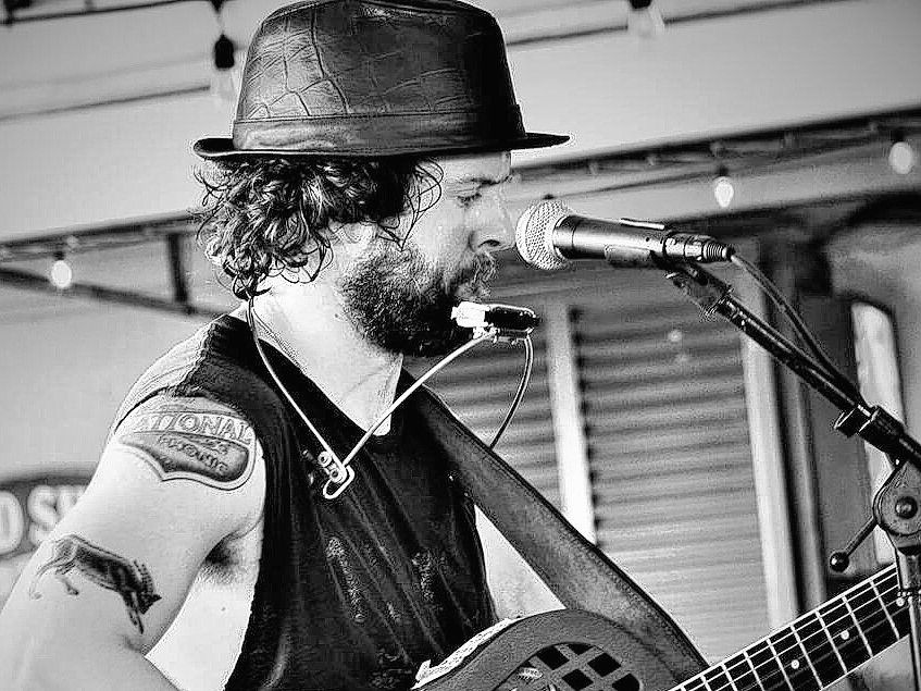 Micah Scott plays the Bookmill on Friday