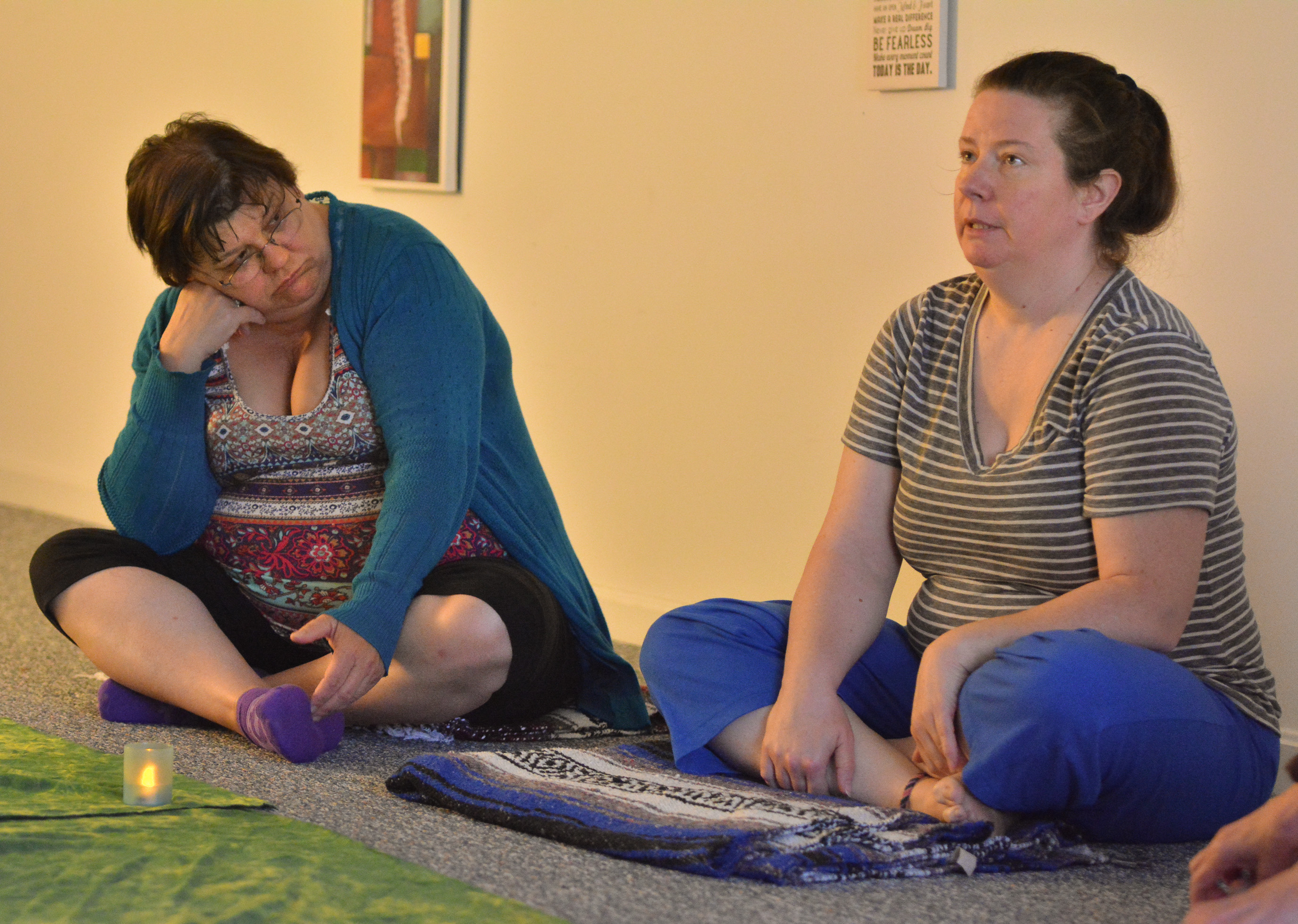 Bekki Strader, right, of Easthampton talks about her life as Jackie Daley, of Woronoco, listens Tuesday at HeartnSoul Yoga and Wellness in Hadley.