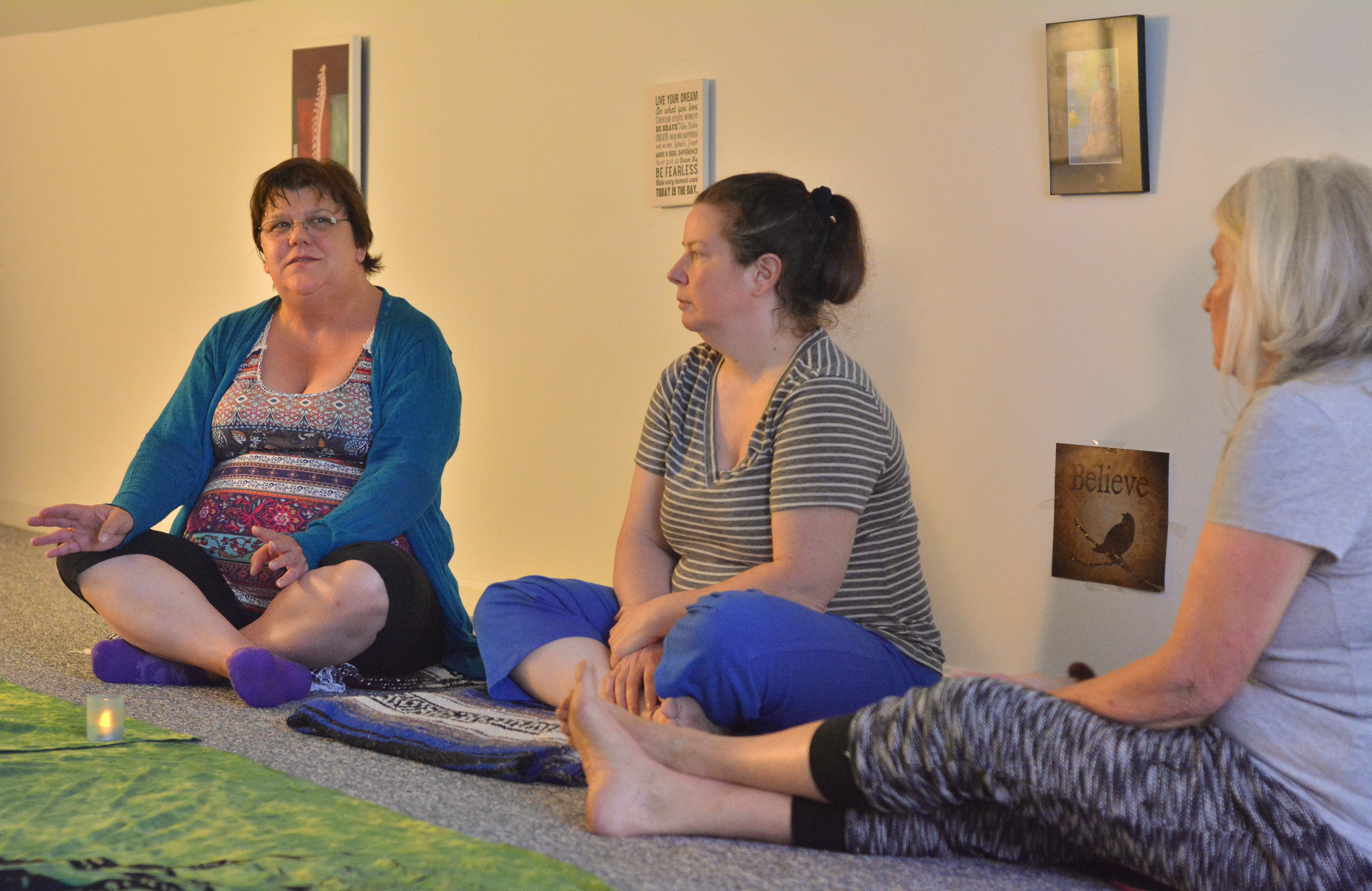 Jackie Daley, left, of Woronoco, talks about her life as Bekki Strader, center, of Easthampton, and Elizabeth Nett, of Northampton, listen, Tuesday at HeartnSoul Yoga & Wellness in Hadley.