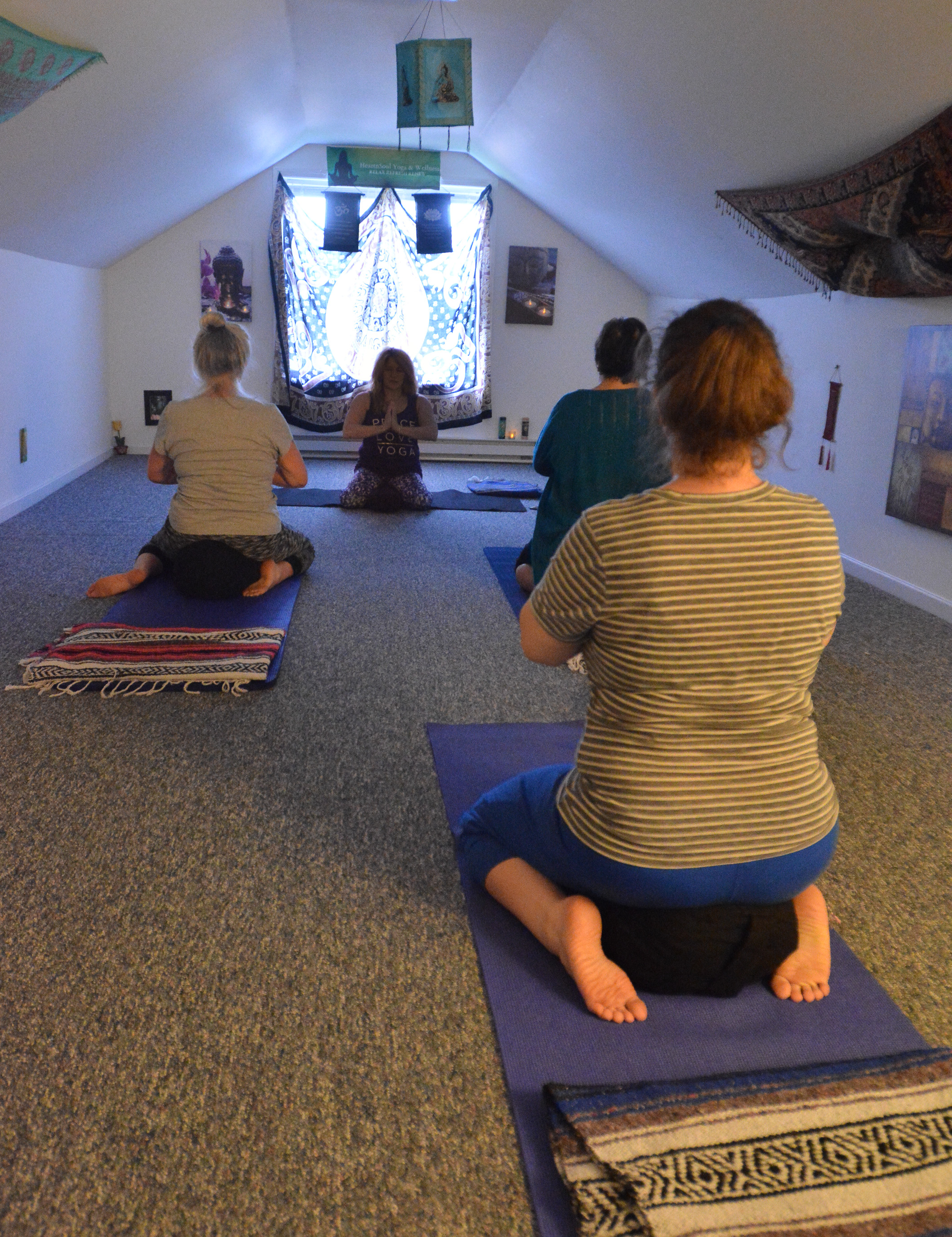 Bonni-Lynne Sandler, center, leads her yoga class Tuesday at HeartnSoul Yoga & Wellness in Hadley.