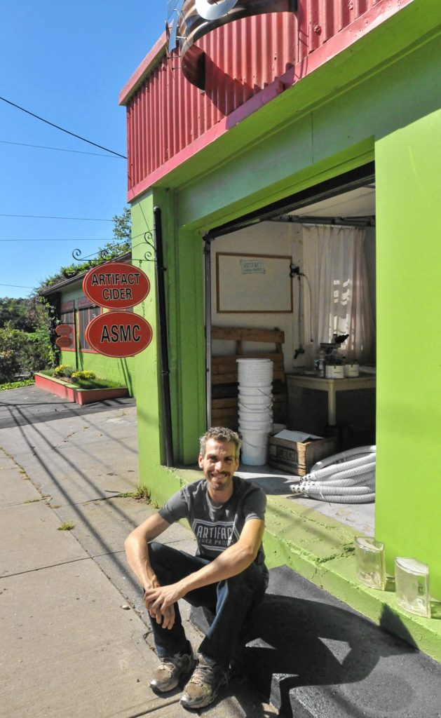 Jake Mazar In Front Of Where He Started His Business Artifact Cider Project  At Gasoline Alley In Springfield.