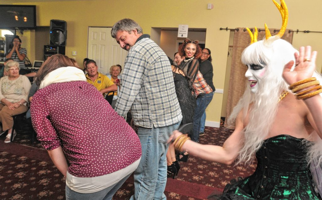 Hors D'oeuvres gives out good luck birthday spankings at Drag Brunch at Slainte in Holyoke. Carol Lollis photo.