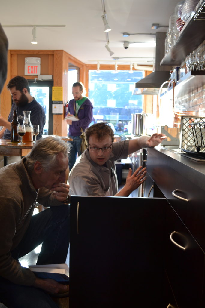 Beerology is now open on Pleasant Street in Northampton. Above, owner Mike Schilling provides a look at the homebrew hub's setup. Hunter Styles photo.