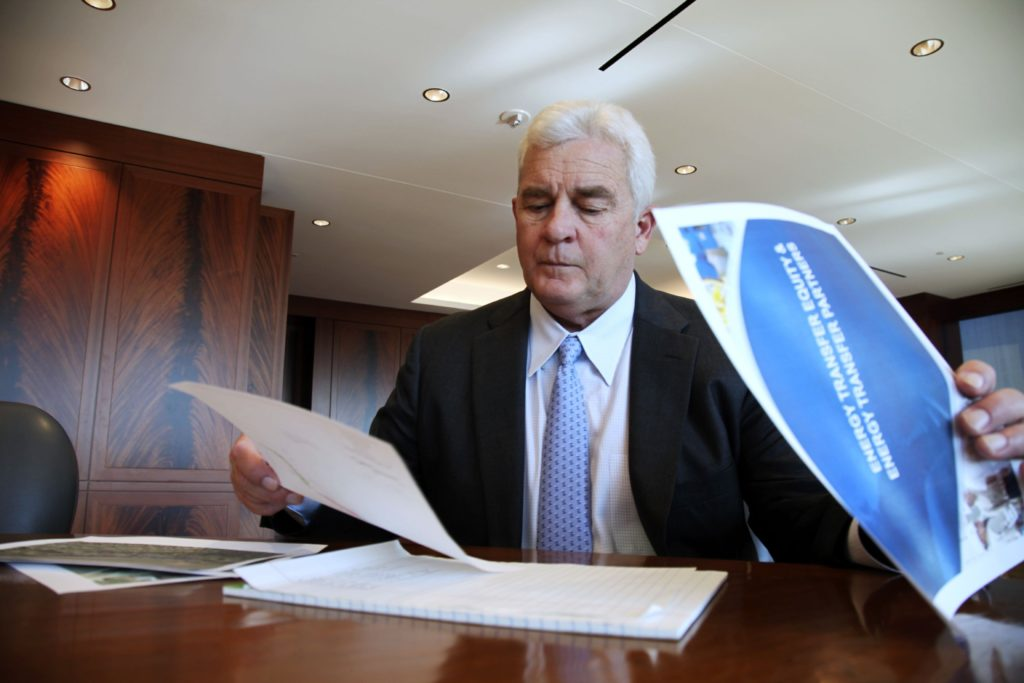 Energy Transfer Partners CEO Kelcy Warren reviews documents at his office in Dallas on Friday, Nov. 18, 2016, about the Dakota Access oil pipeline that is mired in controversy after thousand of protestors have sought to block its expansion underneath a water source close to the Standing Rock Sioux Indian Reservation in North Dakota. (AP Photo/ John L. Mone)