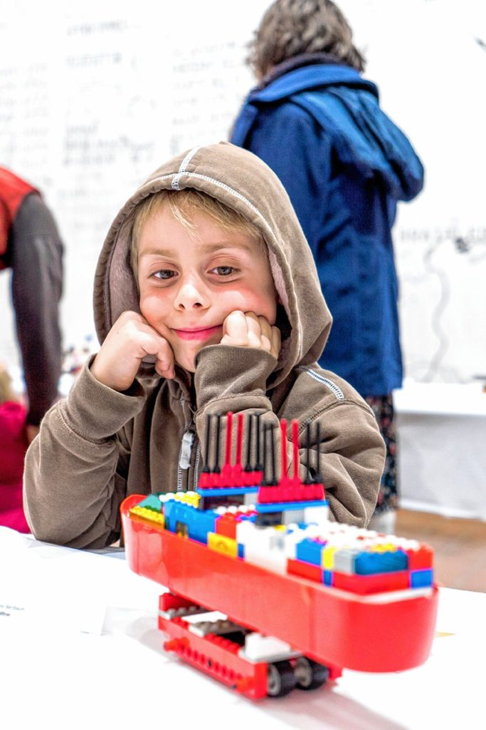 Finn Bernbaum of Brattleboro admires his entry in BMAC's 2015 LEGO Contest & Exhibit (photo by Tobias Gelston)