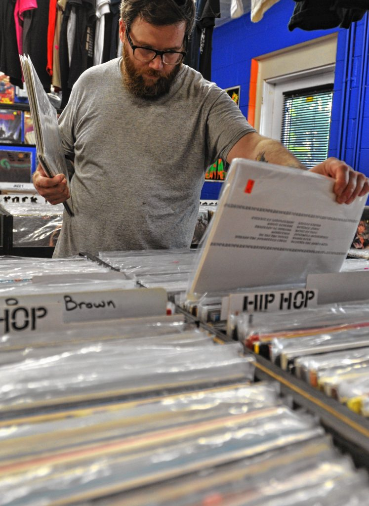Andy Kivela of Easthampton looks through records at Electric Eye in Florence.