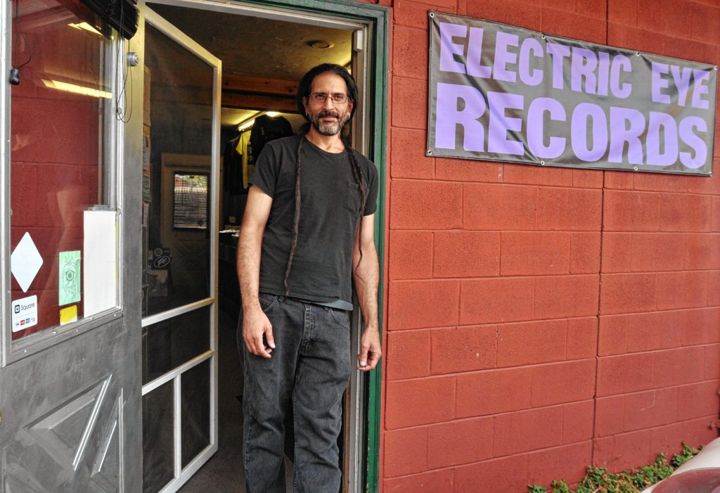 Andy Crespo in front of Electric Eye Records in Florence.