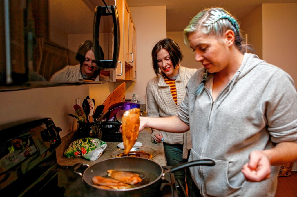 Corinne Moskal, left, and Mary Wilson, both of whom live in Soldier On's transitional housing for female veterans on the Veterans Affairs campus in Leeds, cook together Nov. 16, 2016 in preparation for a house dinner.