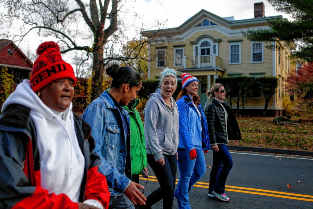Joanne Price, left, peer support Netshari Ortiz, Mary Wilson, Page Policastro, and wellness director Stephanie Ovitt, all of whom live or work at Soldier On's transitional housing for female veterans on the Veterans Affairs campus in Leeds, walk in a Veteran's Day parade Nov. 10, 2016 in Northampton.