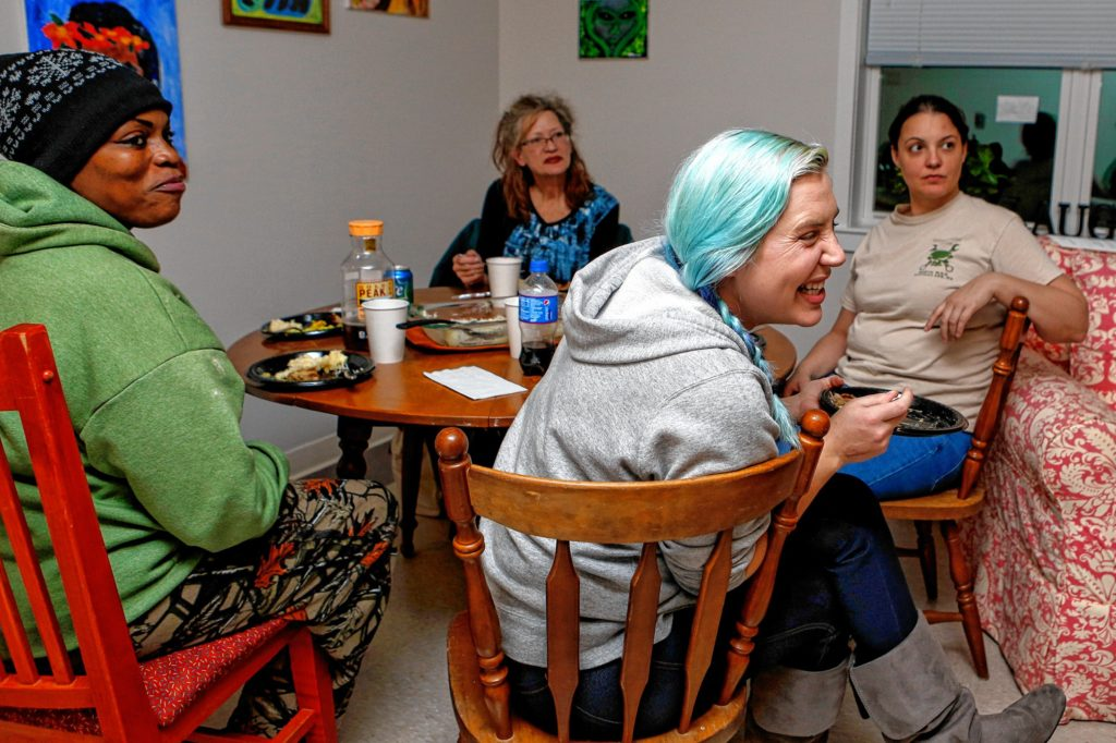Silva Petrus, left, Donna Hilliard, Mary Wilson and Page Policastro, all of whom live in Soldier On's transitional housing for female veterans on the Veterans Affairs campus in Leeds, share a meal Nov. 16, 2016.