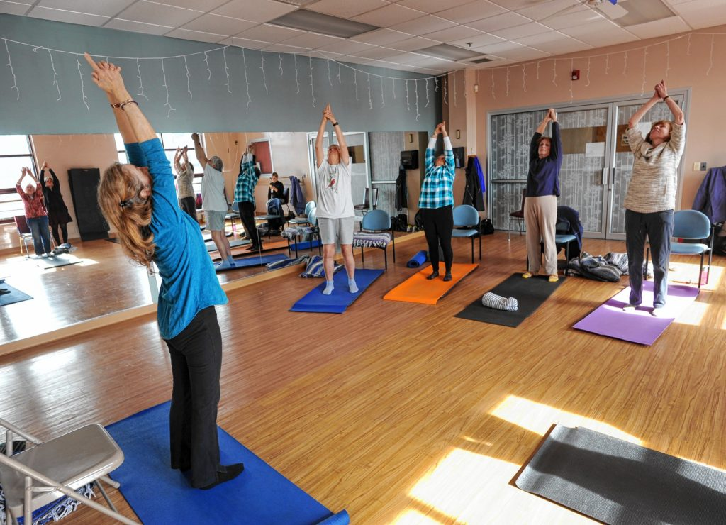 Yoga Instructor Pam Roberts runs a yoga class for people dealing with cancer at the Greenfield YMCA.   February 22, 2017.