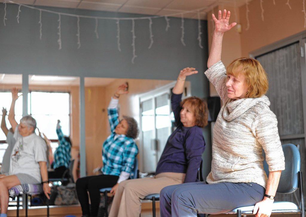 From left, Suzanne Carlson of Greenfield, Kim Audette of Sunderland, Mary Kennedy of Gill and Karen Latka of Montague participate in a yoga class for people dealing with cancer at the Greenfield YMCA.   February 22, 2017.