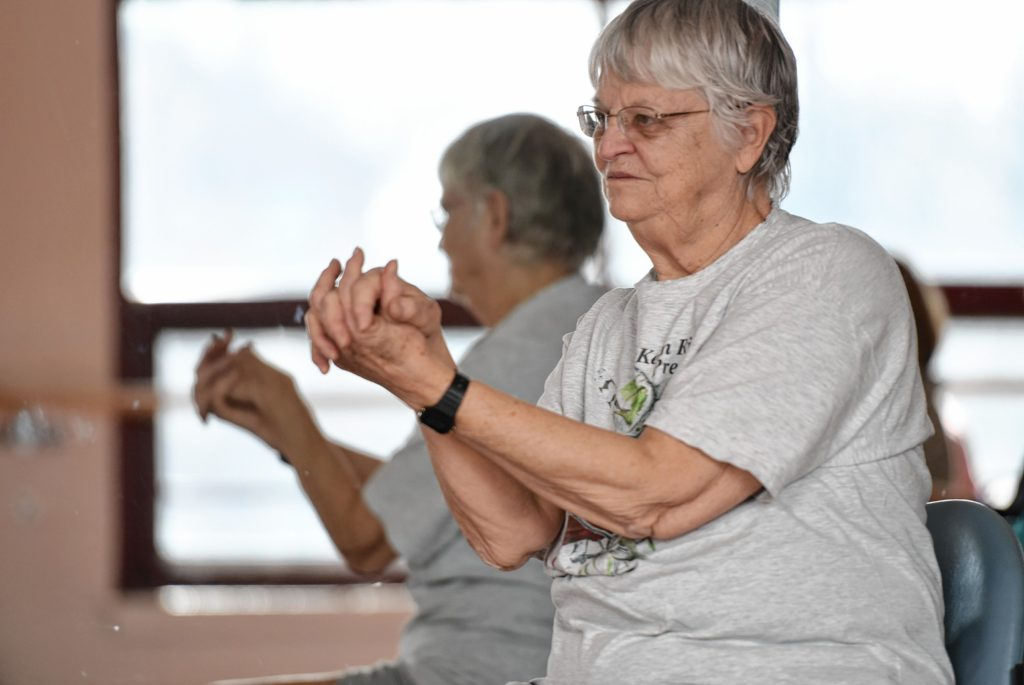 Suzanne Carlson of Greenfield participates in a yoga class for people dealing with cancer at the Greenfield YMCA.   February 22, 2017.