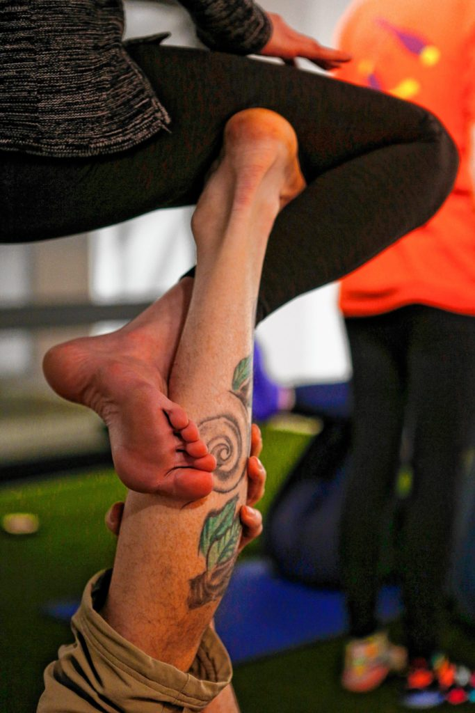 Brian Begley of Pittsfield, left, and Kirsten Jarvis of Easthampton interlock limbs in straddle throne pose March 31, 2017 during an acroyoga meet up at Mill 180 Park in Easthampton.