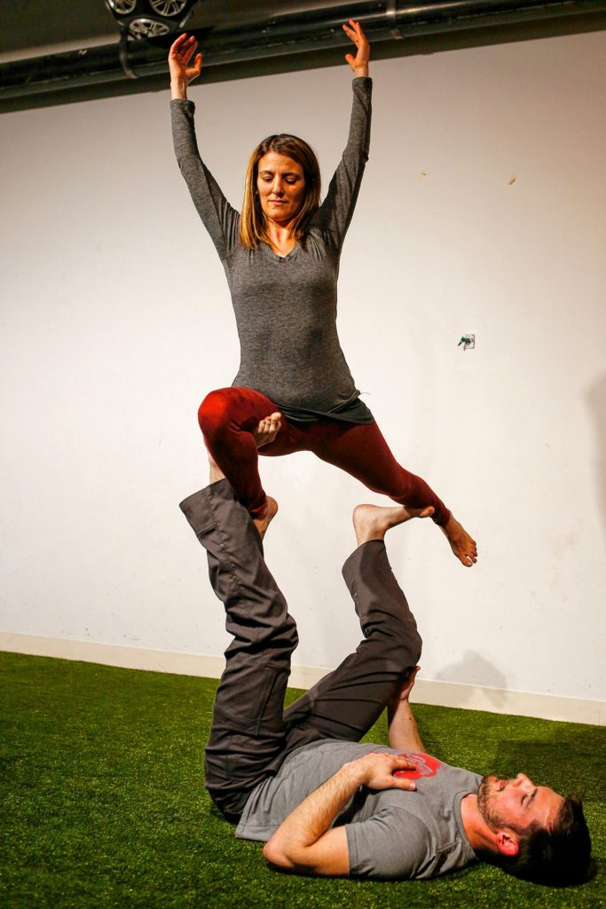 Dorin Ben-Ami of Northampton, top, and Will Witecki of Newington, Conn., perform a straddle throne variation March 31, 2017 during an acroyoga meet up at Mill 180 Park in Easthampton.