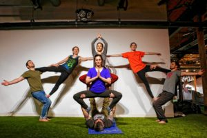 From left, Etai Dvora of Northampton, Hampshire College student Elizabeth Levick, Dorin Ben-Ami of Northampton, top center, Eliana Bronstein of Northampton, Brian Begley of Pittsfield, Hampshire College student Abbi Wilson and Will Witecki of Newington, Conn., perform a group pose March 31, 2017 during an acroyoga meet up at Mill 180 Park in Easthampton.