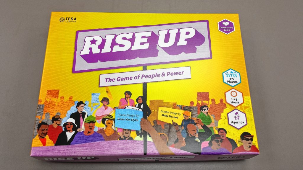 Rise Up, the board game, produced by the TESA Collective, formed from Hampshire College, is a collaborative game about activism.