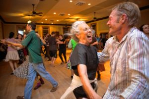 Tina Olsen, 73, of Brattleboro, dances with David Cantieni, Master of the Guiding Star Grange in Greenfield during a contra dance Saturday, October 8.