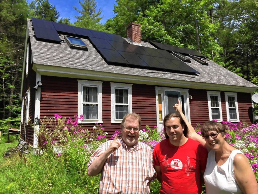 Keith Ross, Simon Ross and Louise Doud in Warwick  pose for a photo in front of the new 6.4 kW solar system on their roof, installed by Co-op Power and NuWatt as one of the first installations for Rays the Valley.