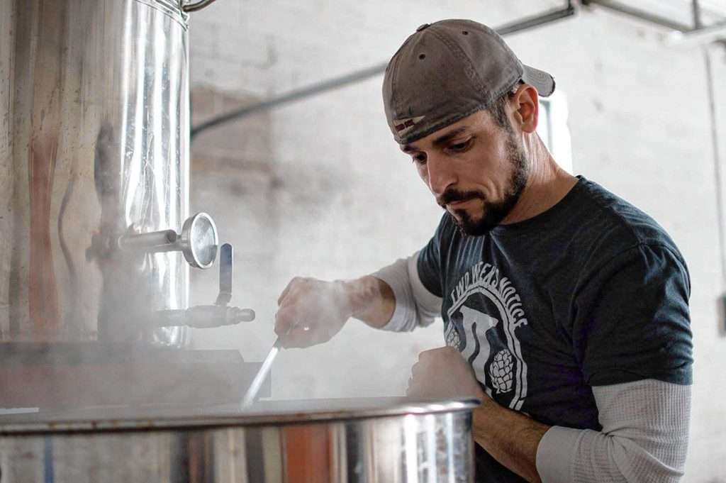 Rich DeSousa (pictured) brews Coffee Break maple coffee stout alongside Mark Avery. Photo by Liz DeSousa.
