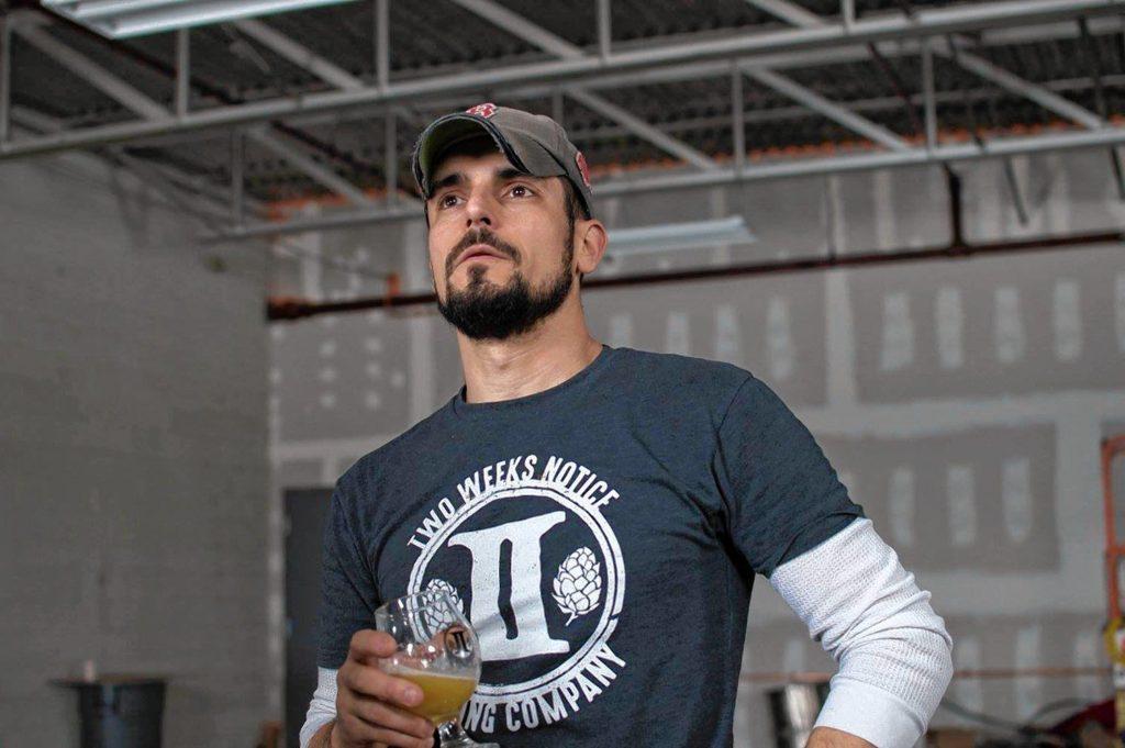 Rich DeSousa (pictured) brews Coffee Break maple coffee stout alongside Mark Avery. Photo by Liz DeSousa.