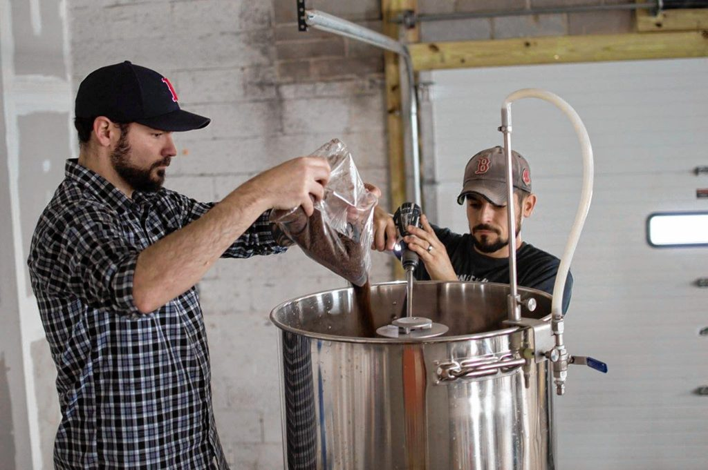 Mark Avery (left) and Rich DeSousa brew their Coffee Break maple coffee stout. Photo by Liz DeSousa.