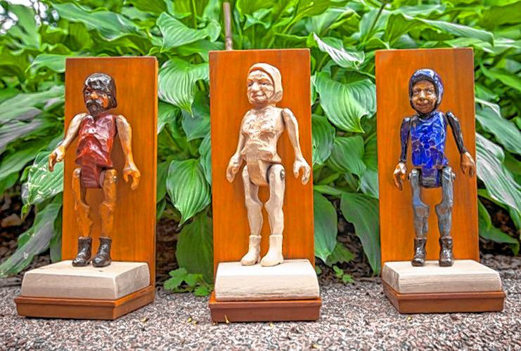 Three of Theo Fadel's carved wooden figures stand on Avenue A in Turners Falls. Their bodies are based on the iconic Hitty doll that was the subject of an early 20th century novel. For The Recorder/Trish Crapo