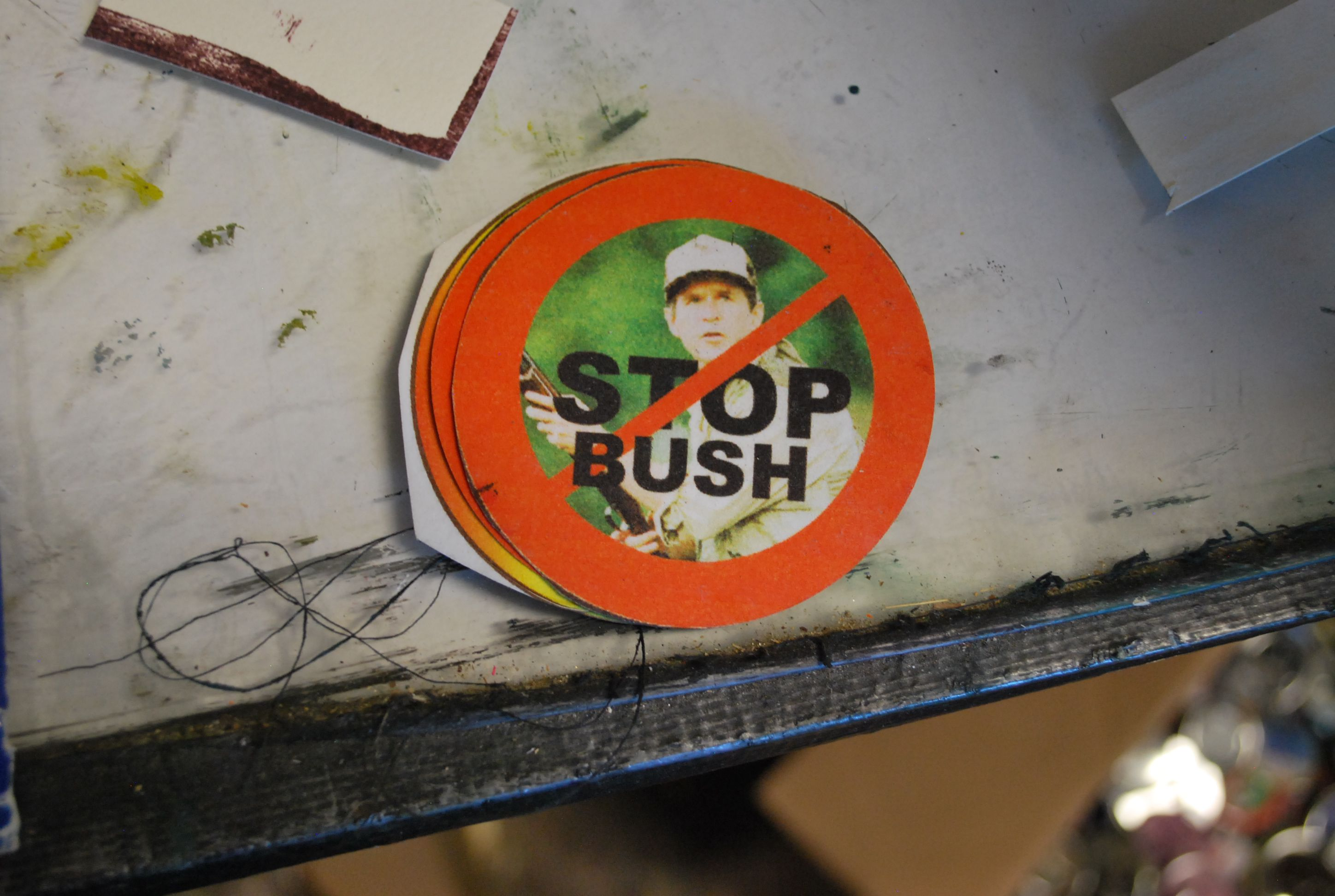 The Button Lady Wearing Dissent On Your Sleeve Utter Buzz My Icon Rakutencouk Shopping Short Circuit Nova Labs Kids Tshirt Is Perhaps Her Most Straightforward A Picture Of George W Bush In His Hunting Gear And Stamped Over Him Bright Orange No Symbol