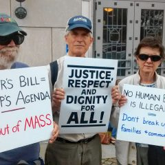 Immigrant Rights Activists Burn Baker on ICE Bill